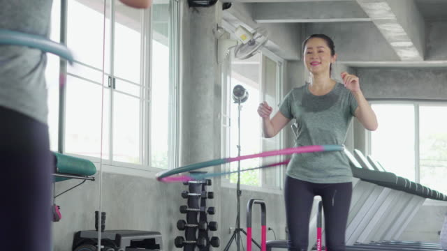 reflection of woman exercising with a hula hoop - plastic hoop stock videos & royalty-free footage