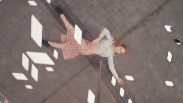 reflection of woman laying on sidewalk - traumhaft stock-videos und b-roll-filmmaterial