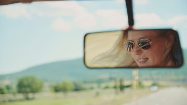 reflection of woman traveling in van - sunglasses stock videos & royalty-free footage