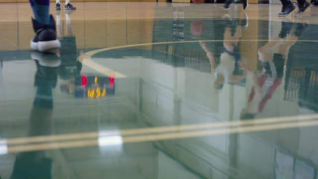 Reflection off Basketball Court of Female College Team
