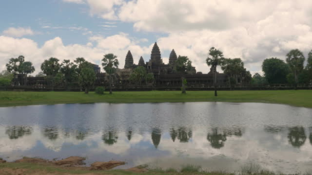 reflection pond angor wat. - cambodian culture stock videos and b-roll footage