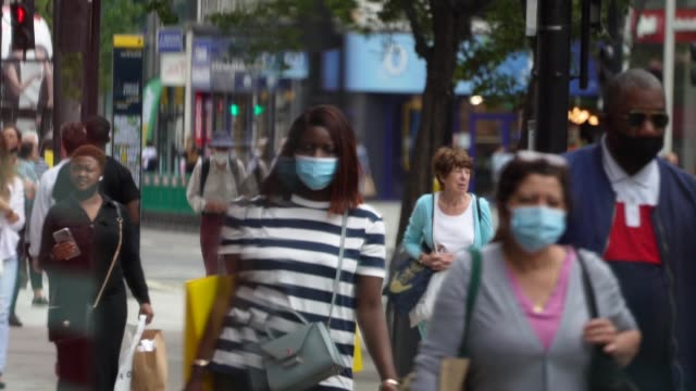 reflection shot of people wearing face masks on oxford street on july 24, 2020 in london, england. from today, it is compulsory for shoppers to wear... - merchandise stock videos & royalty-free footage