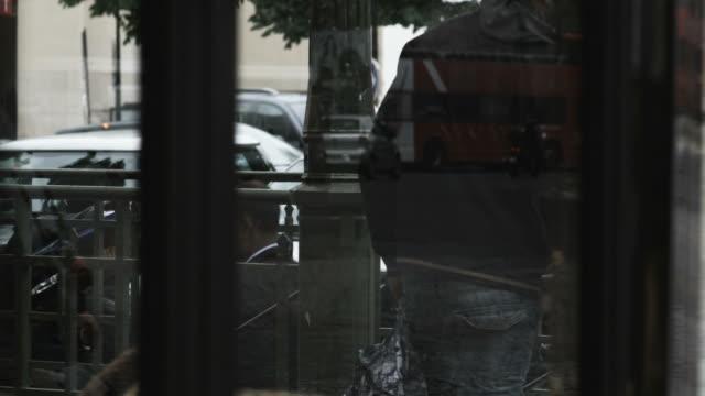 reflections in a store window - mellanstor grupp av objekt bildbanksvideor och videomaterial från bakom kulisserna