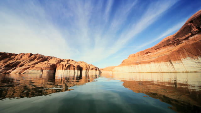 ws pov reflections in lake showing dropping water levels  / arizona,united states    - lago powell video stock e b–roll