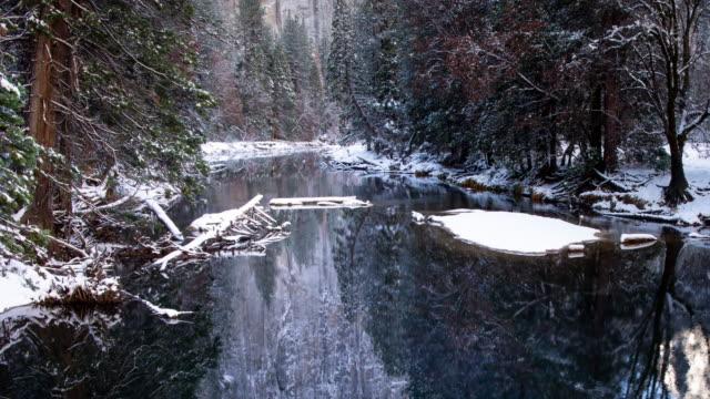 reflections in river winter landscape in yosemite valley - yosemite national park video stock e b–roll