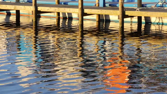 reflections of a jetty and boats at waterhead at the head of lake windermere, ambleside at dusk, lake district, uk. - jetty stock videos & royalty-free footage