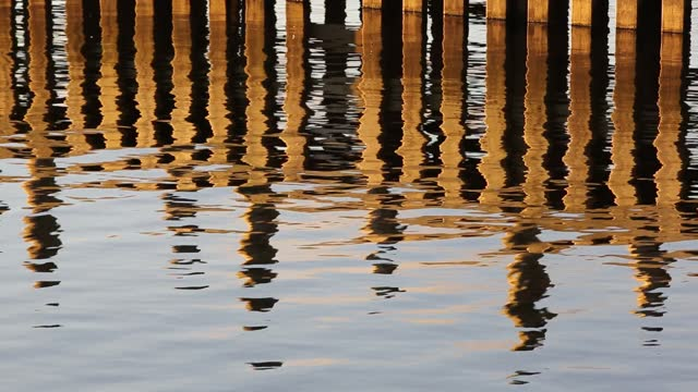 reflections of a jetty at waterhead at the head of lake windermere, ambleside at dusk, lake district, uk. - jetty stock videos & royalty-free footage