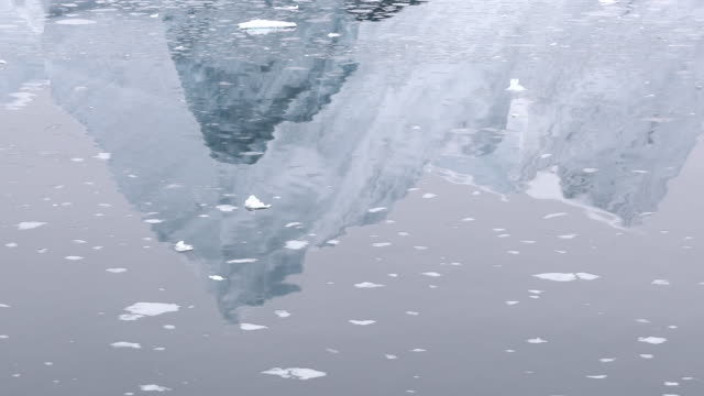 reflections of mountains in antarctica - ice floe stock videos & royalty-free footage