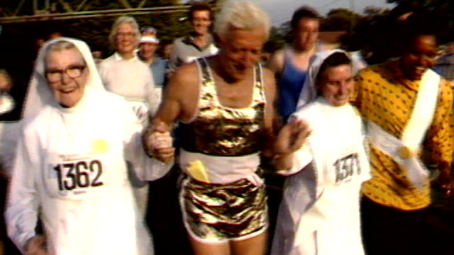 reflections on 2012; 138743 / tx 28.9.1986 england: london: hyde park: ext jimmy savile taking part in fun-run with nuns - running shorts stock videos & royalty-free footage