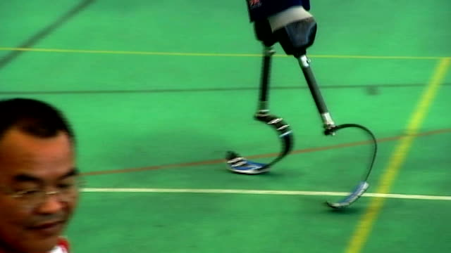 reflections on 2012 t22051225 / tx **snow interview overlaid sot** general views of paralympic athletes warming up various of richard whitehead lying... - olympic rings stock videos & royalty-free footage