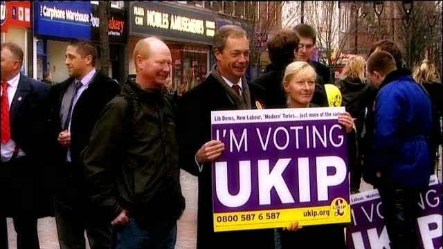 reflections on 2012 t26111242 / tx rotherham ext nigel farage mep holding up poster with slogan i'm voting ukip at time of campaigning for local... - 2012 stock videos and b-roll footage