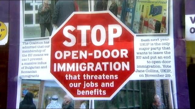reflections on 2012 t28111233 / tx close shot of ukip poster with slogan stop open door immigration - 英国独立党点の映像素材/bロール