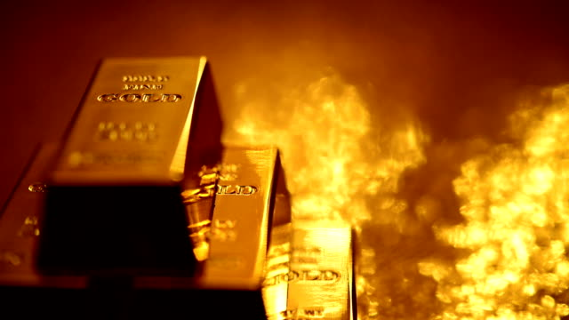 loopable: reflections on stack of gold bars - ingot stock videos and b-roll footage