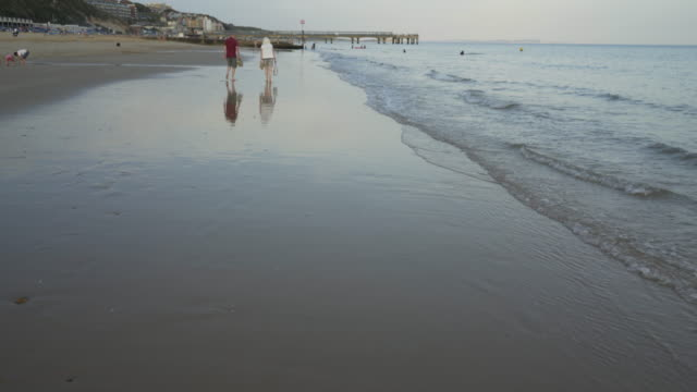 reflections on the beach at dusk. - bournemouth england stock videos & royalty-free footage