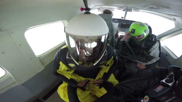 reflections wingsuit pilots exit airplane - sports helmet stock videos & royalty-free footage