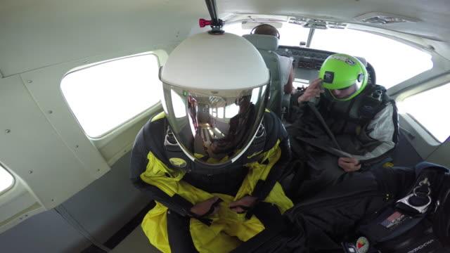 reflections wingsuit pilots exit airplane - sportschutzhelm stock-videos und b-roll-filmmaterial