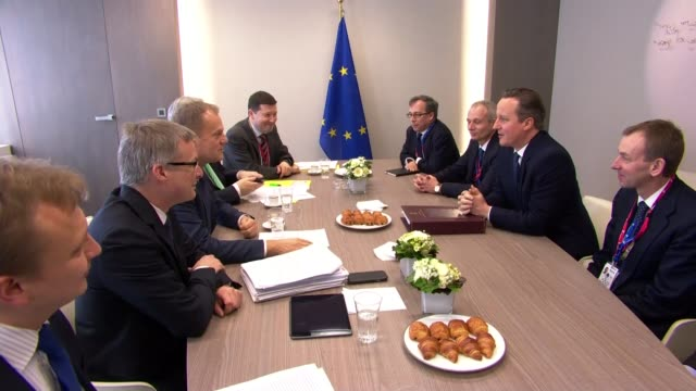 david cameron secures agreement on renegotiation of british position in europe; int various of cameron and advisers, including tom scholar, seated at... - reform stock-videos und b-roll-filmmaterial