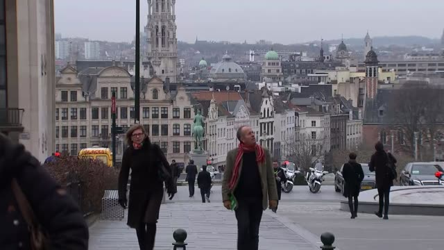 Final talks begin BELGIUM Brussels EXT Bells ringing and view of city from above People along on street View of people along through gardens in civic...
