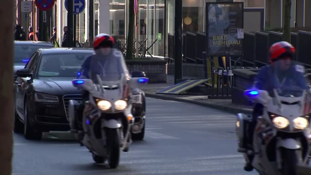 scenes around european commission building belgium brussels ext police officer directing traffic / traffic along / helicopter flying overhead /... - anweisungen geben stock-videos und b-roll-filmmaterial