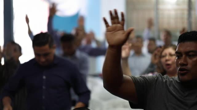 reformed gang members worshipping at eben ezer church service in san salvador - bible stock videos & royalty-free footage