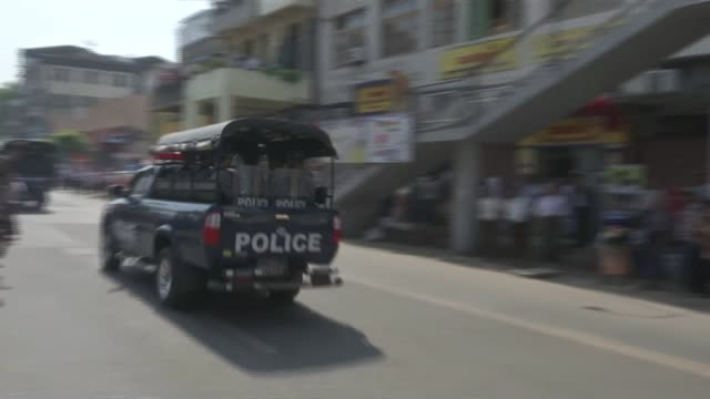 reforming the police force burma / myanmar yangon ext high angle gv of heavy traffic in city centre gv open air market group of police bv two... - temple street market stock videos and b-roll footage