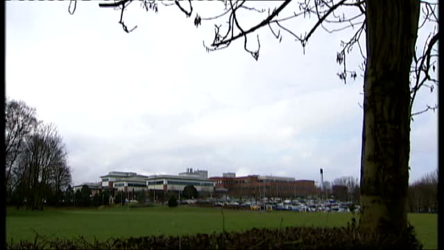 NHS reforms urged after Stafford Hospital report T24021012 / TX Staffordshire EXT Tree branches TILT DOWN wide shot Stafford Hospital buildings Bus...