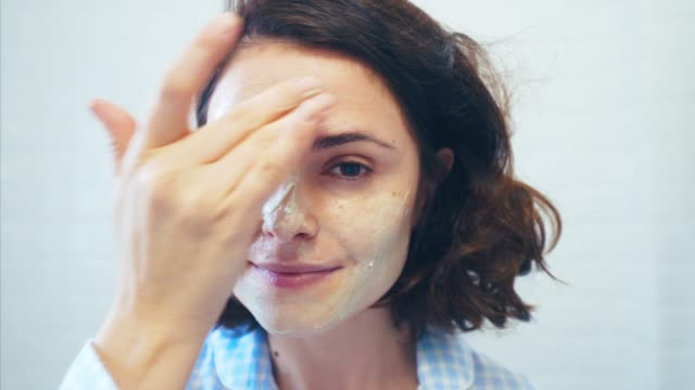 refreshing my facial skin. - beauty treatment stock videos & royalty-free footage