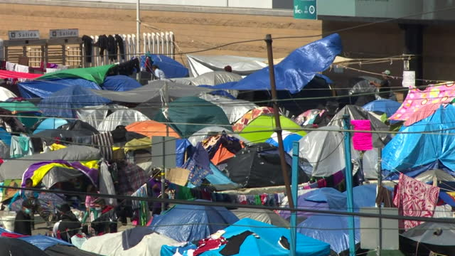 refugee camp in tijuana, by the border wall on the mexican usa border - baja california peninsula stock videos & royalty-free footage