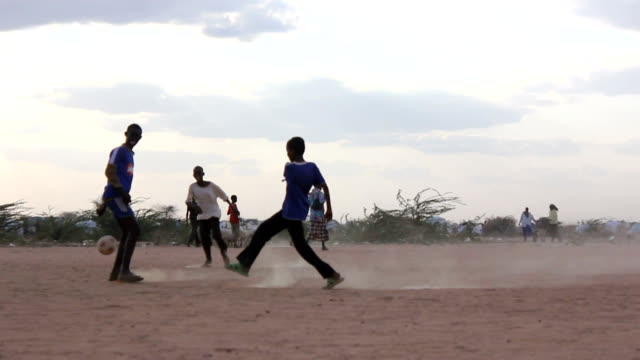 Refugee children playing soccer on August 02 2011 in Road from Garisa to Dadaab Kenya