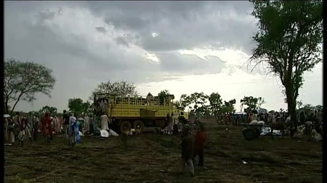 health disaster threat general views of refugee camp with makeshift tents and muddy conditions women stand chatting in camp general view of camp... - makeshift stock videos & royalty-free footage