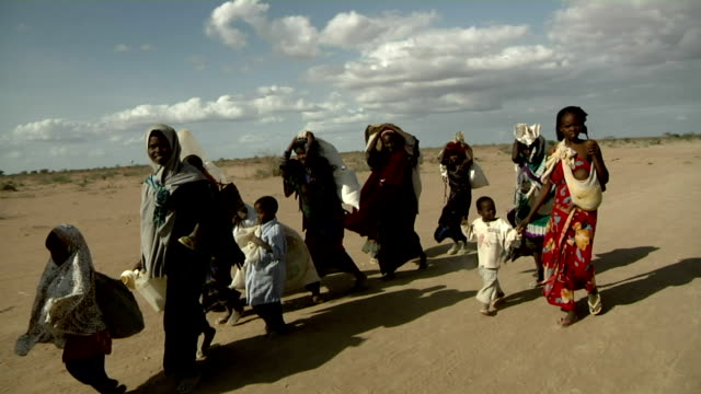 Refugee family arriving at refugee camp on July 30 2011 in Dadaab Kenya