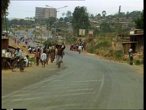refugee returns home; rwanda kigali michael mukassa along l-r as returns home from zaire michael shakes members of tutsi rebel army cms michael along... - キガリ点の映像素材/bロール