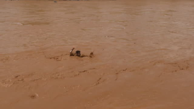 refugee swimming across river to sudan, to escape conflict and ethnic violence in the tigray region of ethiopia - conflict stock videos & royalty-free footage