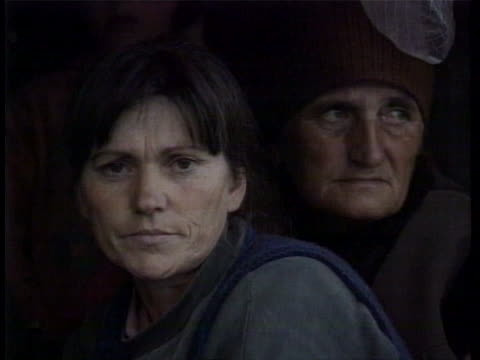 refugee vehicles on road older refugees on wagon two women refugees riding wagon women's faces group of women taking shelter in vehicle - bosnian war stock videos & royalty-free footage