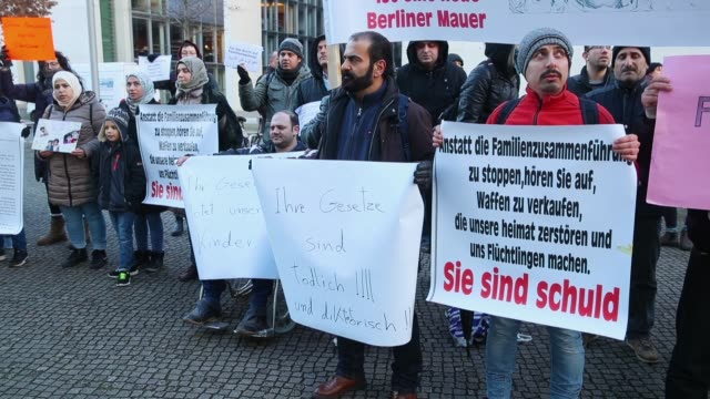 Refugees and migrants protest outside the Bundestag prior to debates and a vote over the rights of refugees who have been granted limited asylum in...