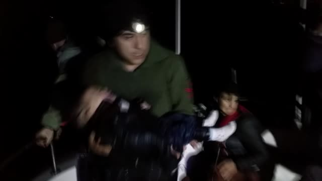 19 refugees are rescued by turkish coast guard while they were illegally trying to reach greece through the aegean sea in aydin turkey on 11 december... - aydın province stock videos and b-roll footage