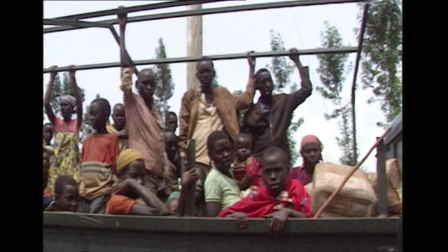 refugees boarding trucks to leave rwanda during the civil war and subsequent genocide 1994 - genocide stock videos & royalty-free footage