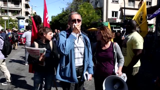 refugees camping at victoria square, are taken to galatsi olympic hall by buses in athens, greece on october 01, 2015. pro-immigrant protestors and... - greece stock videos & royalty-free footage