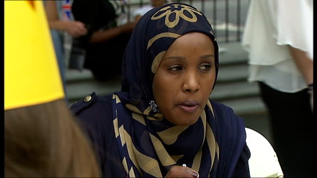 'refugees' celebrate multicultural britain for diamond jubilee brixton ext todiwala interview sot habiba mohamud eating people eating at street party... - street party stock videos and b-roll footage