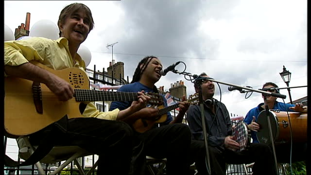'Refugees' celebrate multicultural Britain for Diamond Jubilee ENGLAND London Brixton EXT Brazilian band playing music SOT **Music overlaid SOT**...