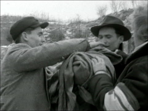 stockvideo's en b-roll-footage met refugees cross border from hungary / refugees at red cross hotel in hampshire austria ext shots of hungarian man crossing river on tree trunk / man... - 1956