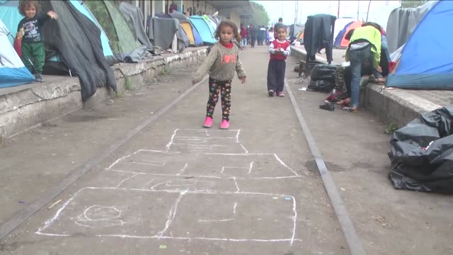 refugees demanding the opening of the greek-macedonian border wait at a temporary refugee camp in the greek village of idomeni, on greece's northern... - サービス業関係の職業点の映像素材/bロール