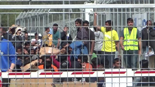 stockvideo's en b-roll-footage met refugees detained in the registration camp of moria demonstrate against deportation on april 5 2016 in moria greece migrants are being returned to... - deportation