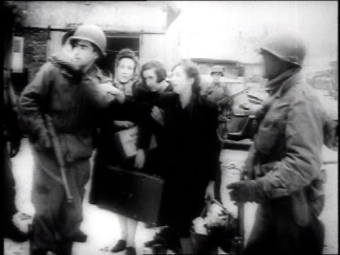vídeos de stock e filmes b-roll de refugees emerge from hiding and are evacuated by the us army as the fighting in their town ends / wingen, germany - 1946