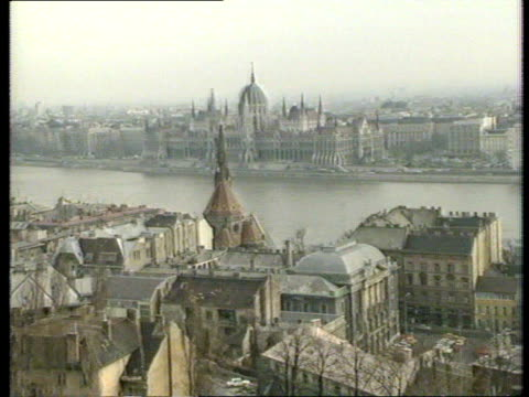 refugees enter west germany via hungary; tx 10.3.1989 hungary: budapest: river danube & city skyline int imre pozsgay pozsgay seated at meeting - budapest stock-videos und b-roll-filmmaterial