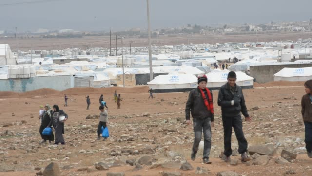 refugees fleeing the fighting in neighbouring syria find temporary shelter in the unhcr run zaatari camp in neighbouring jordan, february 1, 2013.... - temporary stock videos & royalty-free footage