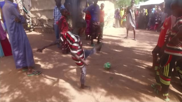 Refugees flock to the Dadaab refugee camp to escape war and famine KENYA Dadaab refugee camp EXT Young boy Minhaj with withered right arm playing...