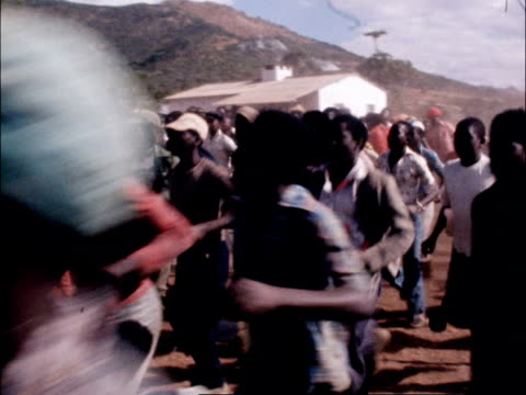 refugees in camp zimbabwe refugees running along as chanting in rythm - rythm stock videos and b-roll footage