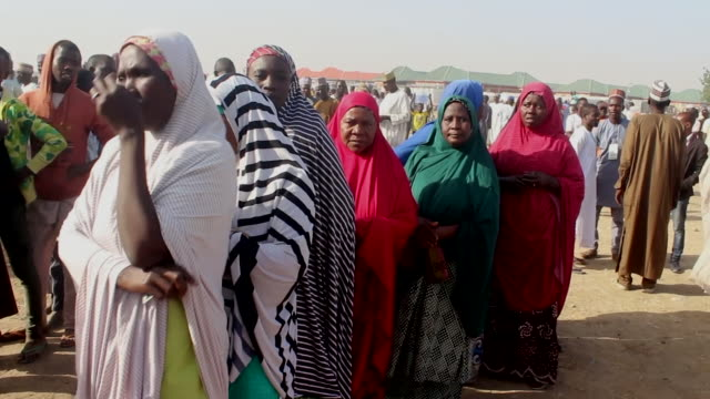 refugees in maiduguri waiting in line to vote in the nigerian presidential election - refugee camp stock videos & royalty-free footage
