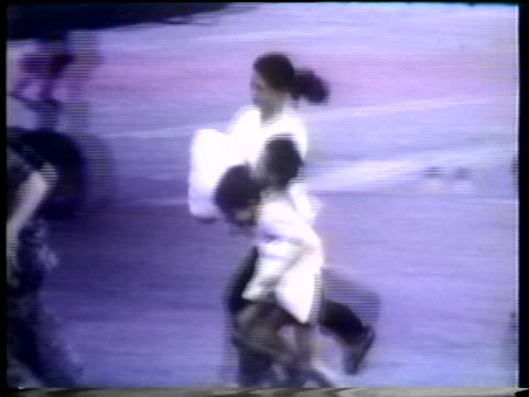 refugees in saigon run to board a united states helicopter in 1975. - helicopter stock videos & royalty-free footage
